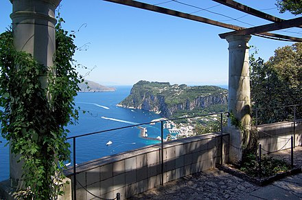 The island of Capri, often seen as a cultural symbol of Campania. Overlooking Capri harbour from the rotunda in Villa San Michele Anacapri 2013.jpg