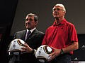 Parreira & Beckenbauer at presentation of World Cup semi-final match balls 2010-07-05 1.jpg
