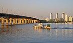 Paton Bridge, the Dnieper River and the Berezniaky neighbourhood at sunset. Kiev, Ukraine.jpg