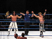 Paul London (far left) and Brian Kendrick (far right) as WWE Tag Team Champions.