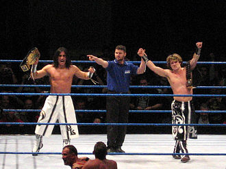 Paul London and Brian Kendrick - Paul London (left) and Brian Kendrick (right) with referee Chris Kay
