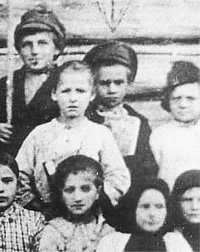 Pavlik Morozov (second row, in the middle): this is the only surviving photograph known of him. PavlikMor.jpg