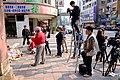 People Photographing Pray Place on Sidewalk 20160330.jpg