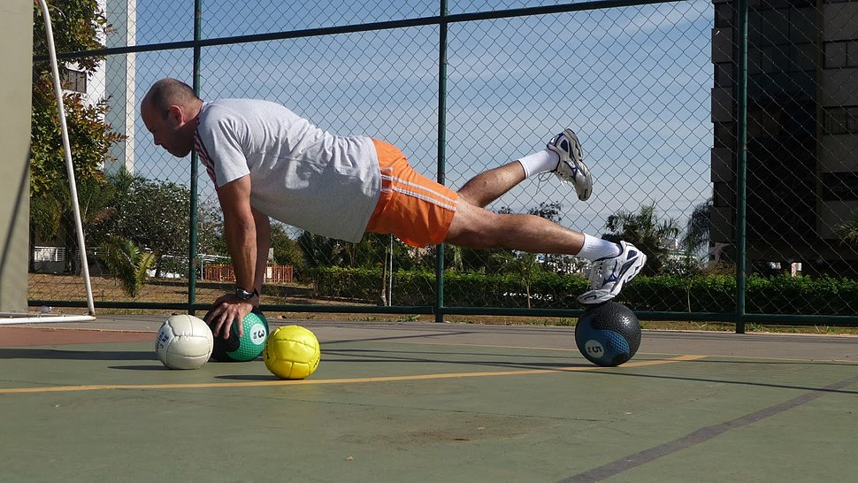 Plank on a pair of medicine balls