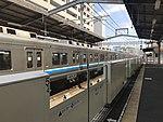 Platform of Meinohama Station and train for Fukuoka Airport Station.jpg