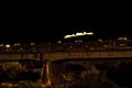 Ponte sul Rio Cavallo e sullo sfondo Castel Beseno - Calliano (TN).jpg