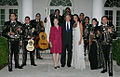 President George W. Bush and Laura Bush pose for photos with singer Shaila Durcal, Dorio Ferreira Sanchez and the Mariachi Campanas de America.jpg