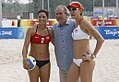 President George W. Bush stands with the U.S. Women's Beach Volleyball team.jpg