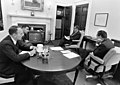 """President Richard Nixon, Michael Collins, William Anders, and Henry Kissinger watch the Apollo 13 Command Module """"Odyssey"""" Splash Down on Television.jpg"""