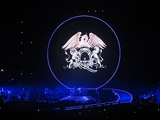 Queen (band) - The Queen logo (pictured at the United Center, Chicago in 2014). A variation of the logo features on the cover of the band's 1976 album A Day at the Races.