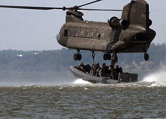United States Army Reserve - Special warfare combatant-craft crewmen attach a naval special warfare 11-meter rigid-hull inflatable boat to an Army Reserve CH-47 Chinook helicopter.