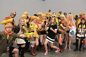 Barbara Dunkelman - Dunkelman with a group of cosplayers dressed as Yang Xiao Long, her character in RWBY.