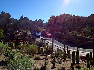 Radiator Springs Racers - Red and blue cars racing side-by-side.