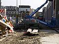 Renovation workers with construction equipment with the old tram depot front in the Tollensstraat, Amsterdam-West . Renovatie van de oude tram-remise gevels in de Tollensstraat, Kinkerbuurt, Amsterdam 2014.jpg