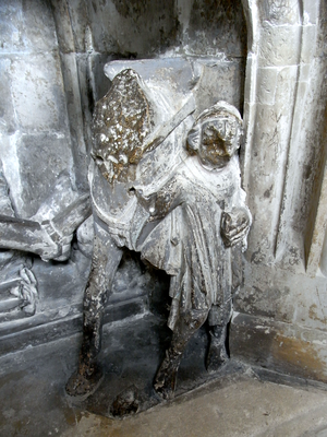 Richard Stapledon - Horse and squire (or a cripple), detail from monument to Richard Stapledon, Exeter Cathedral