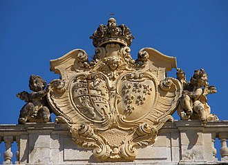 Royal Palace of Riofrío - Shield of the Queen Elisabeth Farnese in the main facade.
