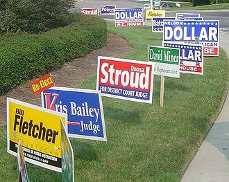 Lawn sign - Election placards placed near a polling location in Apex, North Carolina, July 2004.