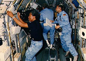 STS-61-A - Bluford, Furrer and Messerschmid at work in Spacelab.
