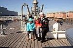 Sailor poses for photo aboard battleship USS Wisconsin 150213-N-GM095-006.jpg
