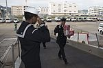 Sailor welcomes Japan Maritime Self-Defense Force Sailors for a holiday gift exchange. (31747153376).jpg