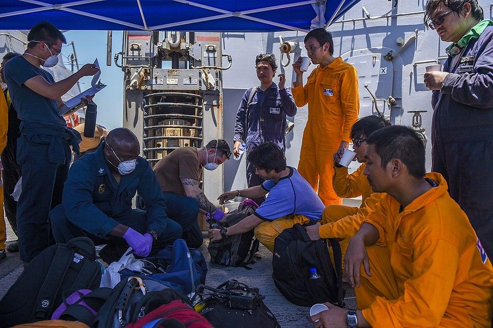Sailors aboard USS Bainbridge (DDG 96) render aid to the crew of the M V Kokuka Courageous. (48062823682)