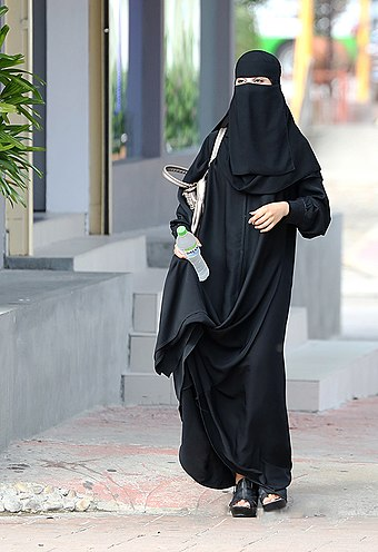 Saudi woman wearing a niqab in Riyadh. Under Saudi law, women are required to wear a abaya but niqab and hijab is optional. Saudi in niqap.jpg