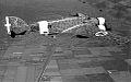 Savoia Marchetti SM 79 Sparviero in volo su campi coltivati.jpg
