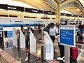 Scenes from American-US Airways PSS at DCA (22224445596).jpg