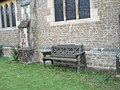 Seat by the parish church wall in Grayshott - geograph.org.uk - 931160.jpg