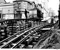 Seattle Electric Co, Madison Street cable car on wooden cribwork during street regrade, Seattle (CURTIS 1472).jpeg