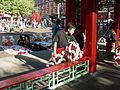 Seattle ID night market - lion dancer prepares.jpg