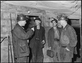 Section foreman, left, gives instructions to miners at last station. Harry Fain, coal loader, is second from left.... - NARA - 541479.tif