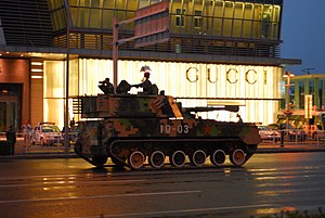 60th anniversary of the People's Republic of China - A PLZ-89 self-propelled howitzer passes the Shin Kong Place Luxury shopping centre during a training exercise, Beijing.
