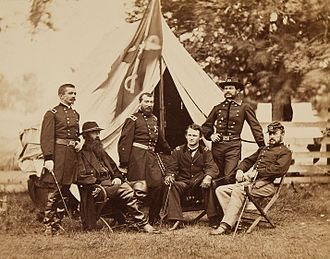 Maj. Gen. Philip Sheridan and his generals in front of Sheridan's tent, 1864. Left to right: Henry E. Davies, David McM. Gregg, Sheridan, Wesley Merritt, Alfred Torbert, and James H. Wilson. Sheridan, Merritt, Gregg, Davis, Wilson, Torbert - HA.jpg
