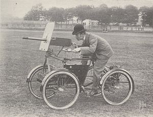 Automotive industry in the United Kingdom - Frederick Simms in his Motor Scout, in June 1899.