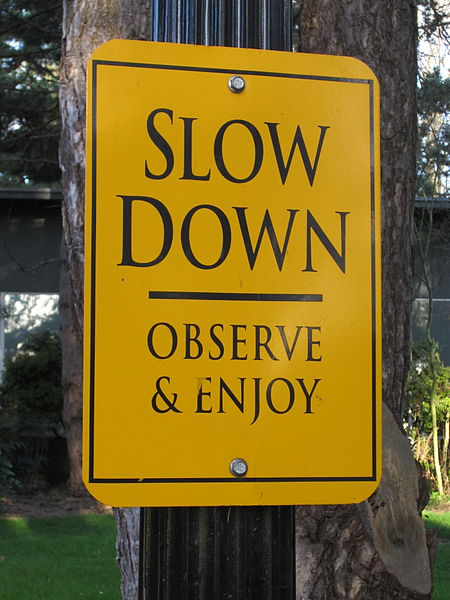 File:Slow down sign, Reed College, Portland, Oregon (2013).JPG