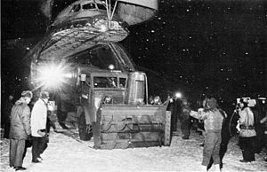 Blizzard of '77 - Snow fighting equipment being unloaded from a C-5A at Niagara Falls International Airport
