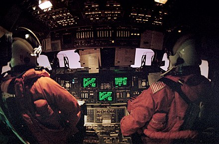 Flight deck view of the Space Shuttle Discovery during STS-42 re-entry Space Shuttle reentry aboard flight deck.jpg
