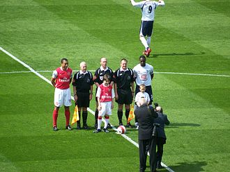 North London derby - Gilberto Silva (far left) and Ledley King (far right), captaining Arsenal and Tottenham respectively at White Hart Lane, on 21 April 2007. The match ended in a 2–2 draw.