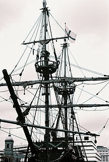Rigging part of a sailing ship including masts, yards, sails, and cordage