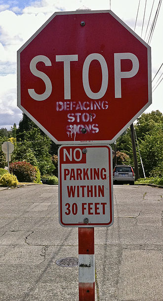 Irony - A stop sign ironically defaced with a plea not to deface stop signs.