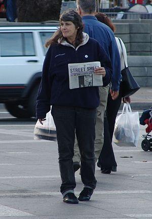 Street newspaper - A street newspaper vendor, selling Street Sheet, in San Francisco