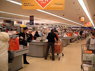 Retailers make many strategic decisions - store type, market served, product assortment and customer services Supermarket check out.JPG