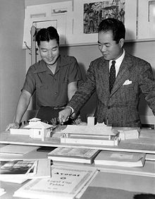 young Eddie Imazu discussing set design with brother-in-law Takashi