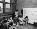 Teacher with groups of students at day school - NARA - 295153.tif