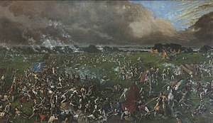 The painting shows many men, some on foot and some on horseback, engaged in hand-to-hand combat.  One man carries the Mexican flag; another carries the flag of the Republic of Texas.  In the background are several tents; behind them is a body of water.