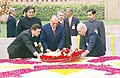 The President of Romania Mr. Ion Iliescu paying homage at the Samadhi of Mahatma Gandhi at Rajghat in Delhi on January 31, 2004.jpg