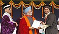 The Prime Minister, Dr. Manmohan Singh presenting the Degree to one of the student of the Banaras Hindu University at the '90th Convocation Ceremony' in Varanasi on March 15, 2008.jpg