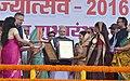 The Prime Minister, Shri Narendra Modi felicitates the beneficiaries of different schemes, at Naya Raipur, Chhattisgarh on November 01, 2016. The Chief Minister of Chhattisgarh, Dr. Raman Singh is also seen (2).jpg