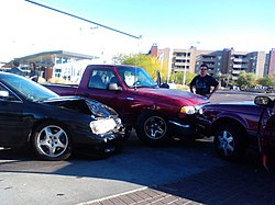 The front ends of three vehicles after an accident